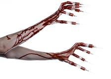 Blutige Hand mit Spritze auf den Fingern, Zehenspritzen, Handspritzen, schreckliche blutige Hand, Halloween-Thema, Zombiedoktor,  Lizenzfreie Stockbilder