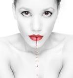 Blutiger Lippenstift Stockfoto
