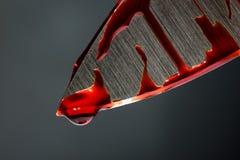 Blutiges Messer Stockfoto