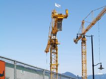 Bly sky with cranes. Big orange cranes against a blue sky backdrop Stock Photography
