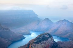 Blyde River Canyon blue lake and mountains in the clouds background, South Africa stock photography