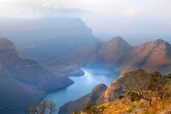 Blyde River Canyon blue lake and mountains in the clouds in sunset light background, South Africa royalty free stock photo