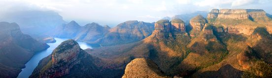 Blyde River Canyon blue lake, Three Rondavels and God`s Window, Drakensberg Mountains national park panorana on beautiful sunset royalty free stock image