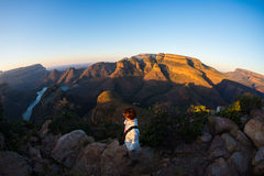 Blyde River Canyon, famous travel destination in South Africa. Tourist looking at panorama at sunset. Last sunlight on the mountai Stock Photos
