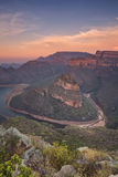 Blyde River Canyon in South Africa at sunset. View over the Blyde River Canyon and the Three Rondavels in South Africa at sunset Royalty Free Stock Photo