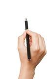 Blyertspenna i hand Fotografering för Bildbyråer