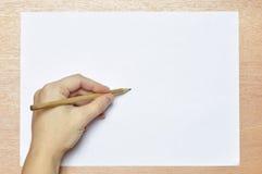 Blyertspenna i hand. Royaltyfria Foton