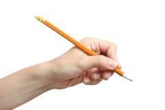 Blyertspenna i vänstersidahanden Arkivbilder