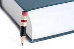 Blyertspenna och bok Fotografering för Bildbyråer