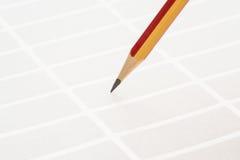Blyertspenna och klibbiga etiketter Arkivfoton