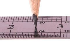 Blyertspenna och linjal fotografering för bildbyråer