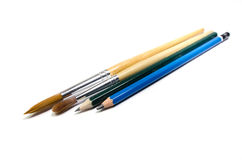 Blyertspenna och målarpensel royaltyfri fotografi