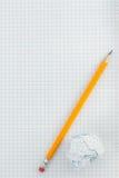 Blyertspenna och skrynklig pappers- boll Royaltyfria Foton