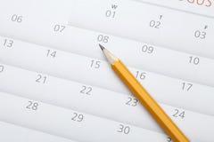 blyertspenna på kalender Arkivbilder