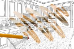 Blyertspenna som raderar teckningen för att avslöja färdig beställnings- kökdesign royaltyfri foto