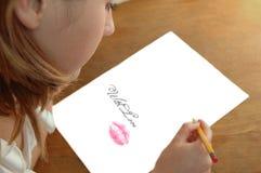 blyertspennakvinnabarn Arkivfoton