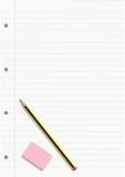 Blyertspennan och radergummit på en fodrad anteckningsbok täcker Arkivbilder