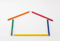 Blyertspennor i formen av ett hus Arkivfoton