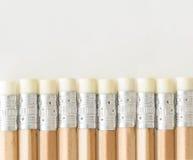 Blyertspennor med radergummisidan upp Arkivbild