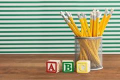Blyertspennor och kvarter Arkivbilder
