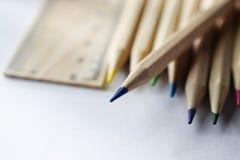 Blyertspennor och linjal p? den vita tabellen royaltyfria foton