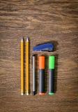 Blyertspennor på en gammal trätabelltabell Fotografering för Bildbyråer