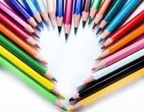 Blyertspennor som skapar en hjärta Fotografering för Bildbyråer