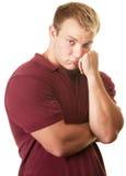 Blyg muskulös man arkivfoto