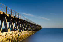 Blyth pier in smooth water Royalty Free Stock Image