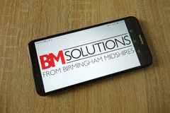 BM Solutions from Birmingham Midshires   logo displayed on smartphone stock photography
