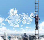 A bman in a ladder is drawing some business diagram on the air. Stock Images