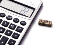 BMI with calculator Royalty Free Stock Image