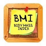 BMI. Etiqueta engomada amarilla en boletín. imágenes de archivo libres de regalías