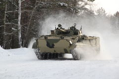BMP-3M on cruise trials in the winter forest. Armament and military equipment, unusual winter landscape, winter testing BMP-3 in mileage Stock Photo