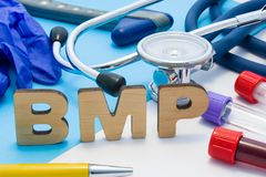 BMP Medical laboratory acronym, meaning Basic Metabolic Panel. Letters that make word of BMP, located near test tubes with blood,. Stethoscope and other stock images