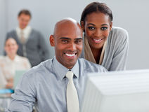 Bmusinesswoman helping her colleague at a computer Stock Image