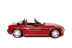 BMV convertible. Red BMW convertible toy car on white background Royalty Free Stock Image