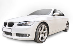 BMW 335i convertible car. Front corner view of BMW 335i convertible sports car - isolated on white Stock Images