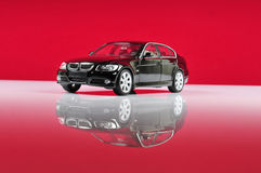 Bmw 3series. Black bmw 3series over red background Royalty Free Stock Images