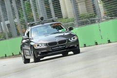 BMW automobile di corso di 3 serie al GP di Singapore Fotografia Stock Libera da Diritti