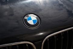 BMW automotive company logo on car bonnet. PRAGUE, CZECH REPUBLIC - MARCH 29 2018: BMW automotive company logo on car bonnet on on March 29, 2018 in Prague Royalty Free Stock Images