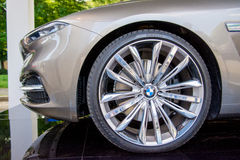 BMW. Car front nose curved with metallic rims Stock Photo