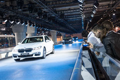 BMW cars at the IAA 2015 in Frankfurt Main. FRANKFURT, GERMANY - SEP 22: Visitors are watching the new BMW cars at the IAA International Motor Show 2015 Royalty Free Stock Images