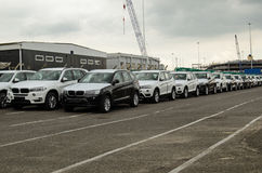 BMW Cars at Southampton Docks. SOUTHAMPTON, UK - MAY 31, 2014:  A consignment of vehicles made by BMW in a queue at Southampton Docks Royalty Free Stock Photo