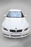 BMW convertible car front. A white BMW 335i convertible sports car Royalty Free Stock Images