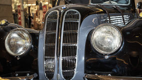 BMW-327/28 Coupe. Moscow, Russia - April 02, 2017: Front headlights and grille of a BMW-327/28 Coupe, Germany 1939,  close up frontal. Retro car exibition in Royalty Free Stock Photos