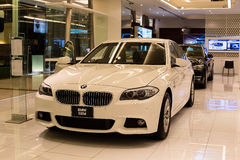 BMW 520d car on display at the Siam Paragon Mall in Bangkok, Thailand. Stock Photos