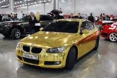 BMW da cor dourada no ` da expo do açafrão do `, 2012 Fotografia de Stock Royalty Free