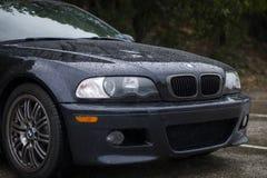 BMW in de regen Royalty-vrije Stock Afbeelding