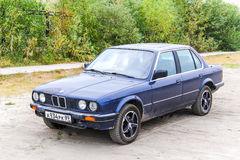 BMW E30 324d. NOVYY URENGOY, RUSSIA - AUGUST 2, 2013: Motor car BMW E30 324d in the city street Royalty Free Stock Image